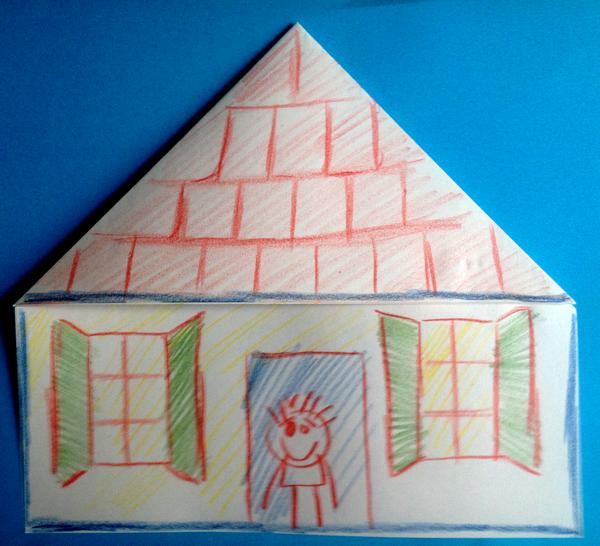 Exemple de pliage facile pour faire une maison avec une feuille de papier pliée et décorée